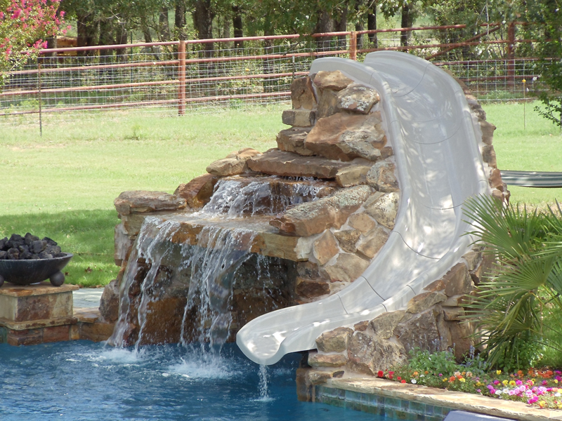 Pool slides seahorse pools spas for Citywide aquatics division swimming pool slide